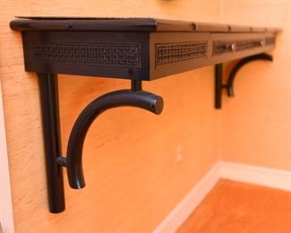 ITEM 115: Wall-mount black shelf  $55  Faux bamboo trim, caned-look front panels. One drawer. Laminate on top is lifting on back left corner. Easily fixed with wood glue, a clamp, and 24 hours.