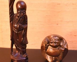 ITEM 118: Two Asian Figures  $20  Carved rosewood figure; round brass Buddha