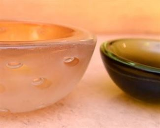 ITEM 120:  Three Art Glass Bowls  $55   L to R: Thick glass bowl with bubbles. The Interior has layers of orange glass and crackled gold encased in clear glass; green-brown shallow glass bowl; sea-green ribbed glass tri-form bowl.