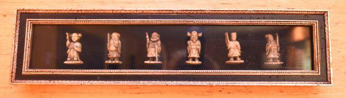 ITEM 121: Framed Netsuke  $38  Six small figures encased in a shadow box.