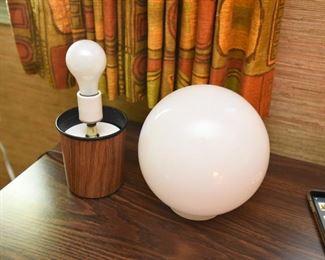 ITEM 127: MCM Globe Table Lamp  $35  Teak-look laminate base. White glass globe. Inline switch.