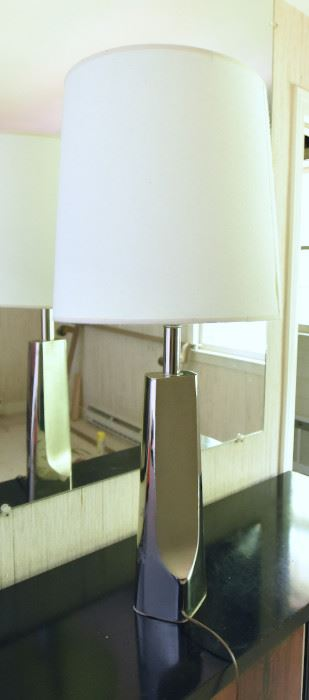 ITEM 128: Unmarked Chrome Lamp  $25  Brushed and polished chrome contrast on this towering lamp. There is something on the chrome that does not come off with a damp cloth. Priced low so you feel better about taking a risk on this.