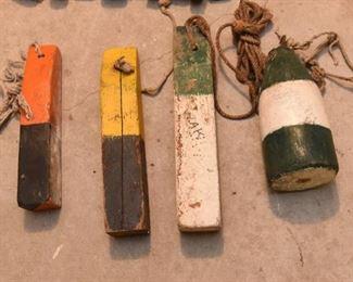 ITEM 133: Lot of 4 Wood Buoys  $45