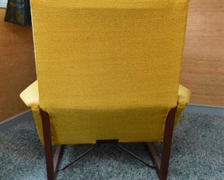 Item 17: Midcentury Lounge Chair & Foot Rest  $425   Unmarked. Upholstered in yellow loose-weave fabric. The upholstery is soiled and has holes at wear points. Frame of both chair and foot rest are sound.
