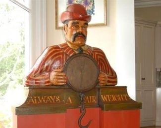 """$1,000  English 1930's Butcher holding Salter's Spring Baranee Scale on removable custom stand. Inscription reads """"Always a Fair Weight"""".  Measures 62"""" High, 40"""" wide,12"""" deep. Base included in overall height measures 28"""" high."""