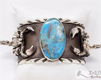 "200:  San Felipe Jacob Troncosa Sterling Silver Cuff Bracelet With Turquoise Value $2500.00 This is a magnificent Native American silver bracelet having a huge Pilot Mountain turquoise oval centered between 2 intricately hand carved silver scorpions on a large hand carved solid silver cuff with rounded hand carved silver borders! The inner cuff has silver hand stampings all around! Truly Stunning! The largest silver scorpion measures about 1-1/2"" x 1"". The center stone measures around 1-3/8"" x 3/4"". The width of the bracelet measures around 1-1/2"". San Felipe artist, Jake Francosa. Sterling silver, marked. The inside end to end measures around 5-7/8"" with an additional 1"" gap. Sturdy 105 grams.Weighs Approx 106.8g"