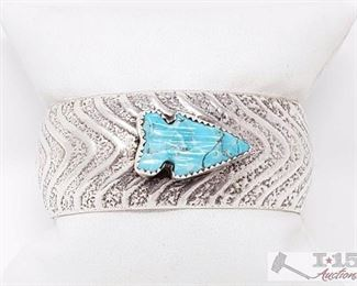 """201  AMAZING VINTAGE NATIVE AMERICAN NAVAJO ARROWHEAD TURQUOISE STERLING SILVER BRACELET Value $800.00 Here we have an amazing vintage Navajo silver bracelet having a hand carved turquoise arrowhead centered on a large hand carved solid silver cuff with a textured convex surface! Very Unique Piece! The center stone measures around 7/8"""" x 1/2"""". The width of the bracelet measures around 1"""". Sterling silver, marked. The inside end to end measures around 5-3/4"""" with an additional 1-1/4"""" gap. Sturdy 47 grams."""