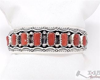 """202 Impressive Vintage Navajo Coral Sterling Silver Bracelet Old Native American. 202  Impressive Vintage Navajo Coral Sterling Silver Bracelet Old Native American Value $750.00 We are proud to offer this wonderful vintage Navajo silver bracelet. Here we have a fantastic hand stamped shadowbox design to host these 7 intense coral stones! The largest stone measures around 3/8"""" x 3/16"""". The width of the bracelet measures around 3/4"""". Signed by Navajo artist, Wil Musket. Sterling silver, marked. The inside end to end measures around 5-1/4"""" with an additional 1"""" gap. Sturdy 38 grams."""
