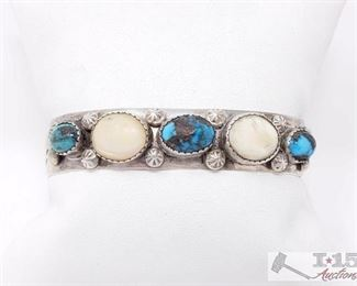 """204 Stunning Vintage Navajo Native American Jewelry Bisbee Turquoise Sterling Silver Bracelet. Value $1199.00 This is an exquisite vintage Navajo Native American jewelry Native American jewelry very rare silver bracelet. This piece contains three amazing Bisbee turquoise stone with two accenting pearls. Nestled throughout the stones and shells are marvelous silver shells. Resting on the ends of the bracelet are incredible silver sun patterns. The center stone measures around 3/8"""" x 1/4"""". The width of the bracelet measures around 1/2"""". Signed by Navajo Native American jewelry Native American jewelry artist, Paul Boone . Sterling silver. Cir. 1970's+. The inside end to end measures around 5"""" with an additional 1-1/4"""" gap. Sturdy 30 grams."""
