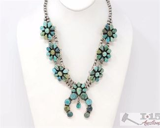 """223 Gorgeous Turquoise Cluster Squash Blossom Sterling Silver Necklace. Value $1500.00 Navajo green and blue turquoise stones and sterling silver cluster squash blossom necklace.  Stunning turquoise stones in many differnt colors form the best mines. Signed P and marked sterling.Please note the item is much more beautiful than the photos show.It measures 22"""", the blossoms are 1-1/4"""", and the naja is 2-1/2"""" X 2"""".The total weight is 157.0 grams."""