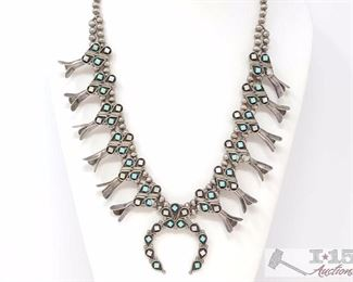 226 VTG Native American Zuni Elliot Gasper Silver Squash Blossom Naja Necklace Beads. Value $1500.00 VTG Native American Zuni Elliot Gasper Sterling Squash Blossom Naja Necklace Beautiful signed necklace. Unique partial double strand of silver beads Mother of pearl and turquoise Measures 23 inches end to end. In great vintage condition. Weighs Approx 86.2g.