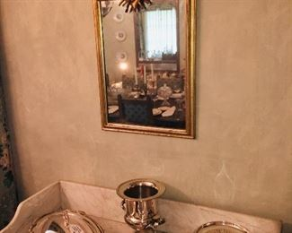 beautiful mirrors and many pieces of early Sheffield plate serving pieces