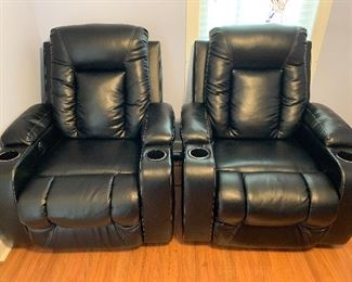 #10	Leather electric reclining theater seating chairs  2@$150 each	 $300.00