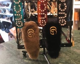 Faux Chanel and Gucci hair clips/berets are priced at $75