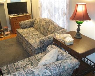 Matching loveseat and sofa, wood table with drawer and table lamp