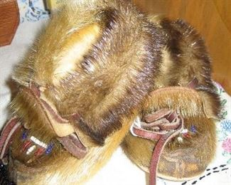 Native American baby-sized fur moccasins