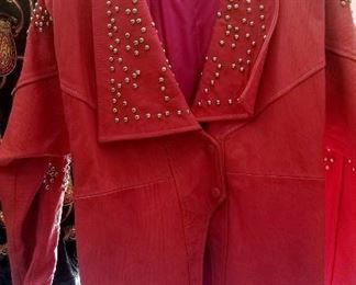 1a  3/4 pink leather  coat with studs size medium.  $25