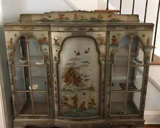 "Chinoiserie cabinet, silvered all over with painted with Asian figures in a landscape.  Wood with glass on the sides and in the front.  The paint has come off of the feet in areas and there is some minor chipping to the paint on the piece itself.  It measures approximately 52 1/2"" high, with an additional 4"" for the back piece at the top,  53"" wide and  15"" deep.  Price: $350.00"