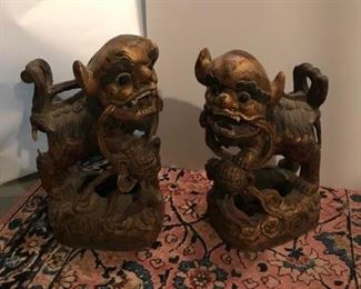 "These are a pair of early 20th Century Chinese wood carved Foo Dogs.  They retain their original gilding and painting.  There is minor loss to the wood at the back of one of the pair.  Otherwise, they are in very good condition.  Highly decorative.  They measure 9"" wide and 16"" tall.  Price: $325.00"