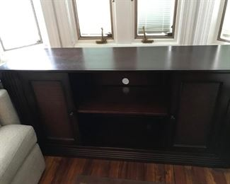 "Bloomingdale's West Indies Console.  Center removable shelf with hole cut for wires, two side cabinet doors with a removable shelf in each.  It measures 58 1/4"" wide, 29 1/2"" tall and 14 1/2"" deep.  Price: $250.00"