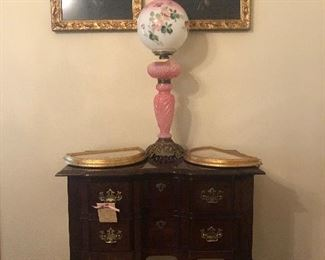Needlepoint pictures, old globe lamp, low boy,