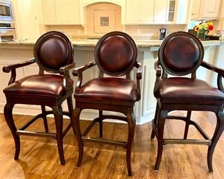3 swivel (bar height) barstools by Frontgate