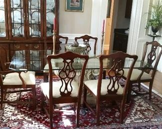 8 Chippendale chairs, a glass top table with a heavy plaster base (the rug and china cabinet in this photo are not for sale)