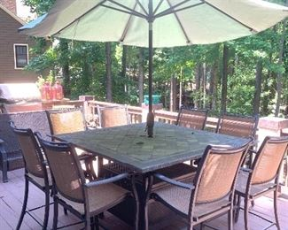 slate-top bistro height umbrella table with 8 chairs