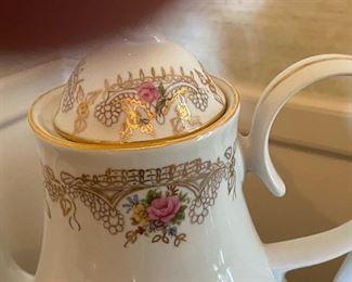close up of pattern on tea set