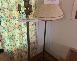 Beautiful floor lamps.  Vintage heavy iron. One base lights up.