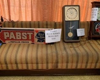 Great old day bed. ONE beer clock left (middle one) at $50