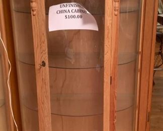 2 unfinished china display cases.  Great price! Christmas Santas from around the world.