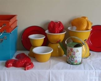 """Lot 1: Colorful lot of kitchen items. PLACE A BID OR """"BUY-IT-NOW for $40. Red. Yellow and orange  Enamelware plates and bowls. Tole watering can.. Metal storage bins. Plastic wall decor Assortment of Plastic and metal  Orange, red, yellow!  7 stackable bowls  3 bins"""