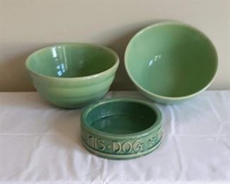 Lot 2: Two matching green 'Bauer' mixing bowls 9.5in diameter. PLACE A BID OR BUY-IT-NOW  for $70. Minor wear to bowl rims. McCoy arts & crafts period dog bowl -- has a hairline crack and minor glaze chips at rim.