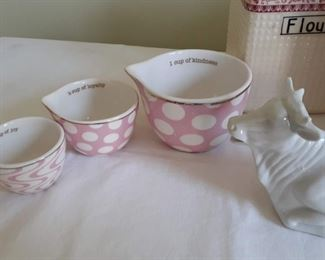 Lot 3: Vintage kitchen canister set ( 10 ct, one top cracked)  Three stacking bowls Adorable cow creamer