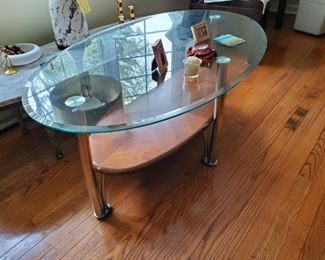 Glass, chrome and wood coffee table 46Lx28Wx18H, has matching end tables, $125