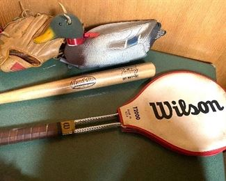 Sports equipment including Wilson tennis racket and bat