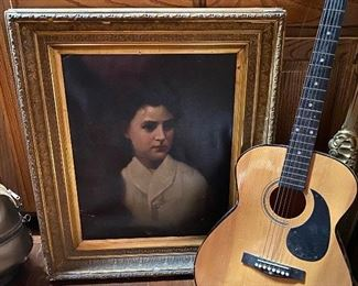 Old painted portrait and guitar