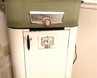 Vintage roaster with white metal cabinet and clock which works