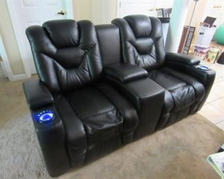 Motorized Leather Recliner Pair, Retail Value $1500
