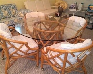 Glass top table with 4 chairs on wheels