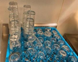 Lot of glasses and 6 assorted dish wash racks