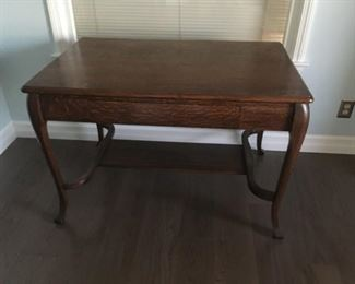 . . . a beautiful eary 1900's solid oak library table!