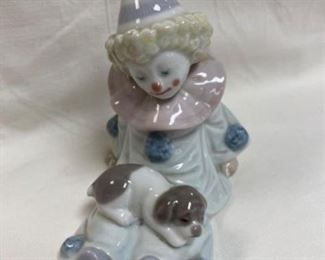 "Signed  Lladro  $100 Figurine is 4.5"" tall and signed on the bottom."