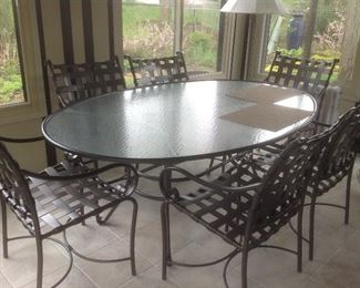 """Patio oval table with six chairs.  Measures74"""" L x 50"""" w x 30"""" tall.  Has never been outside.  Presale $275"""