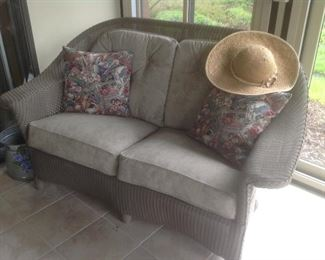"""Wicker Loveseat with grey suede cushions.  Measures 60"""" long x 36"""" deep x 38"""" tall.  Never been outside.  Presale $125"""