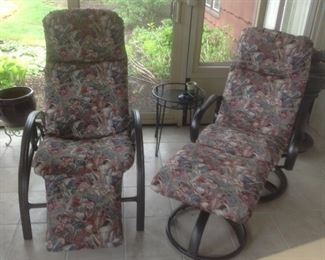 Left chair reclines...right chair swivels and rocks.  Outdoor chairs but have not been outside.  Presale at $100 each or $175 for pair.