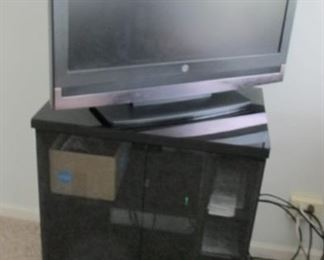 "$40.00  tv stand 31 x 27 x 19 and 32"" Westinghouse tv $25.00"