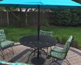 $285.00 original Woodard table, 4 painted Woodard style chairs, cushions, Umbrella  & Stand