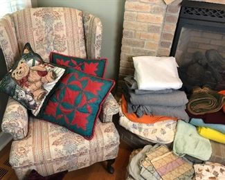 Wing back chair, pillows, blankets, throws and quilts